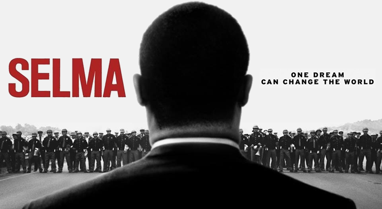 Selma Movie Poster: Photo of Martin Luther King, Jr. facing police officers and other law enforcement.