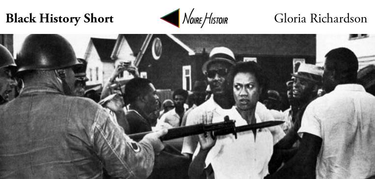 Blog feature image depicting Gloria Richardson brushing aside the bayonet of a national guardsman.