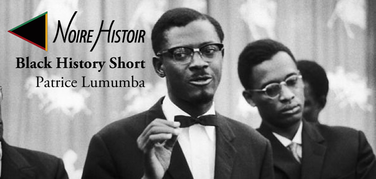 A black and white photo of Patrice Lumumba speaking while Joseph Mobutu stands in the background.