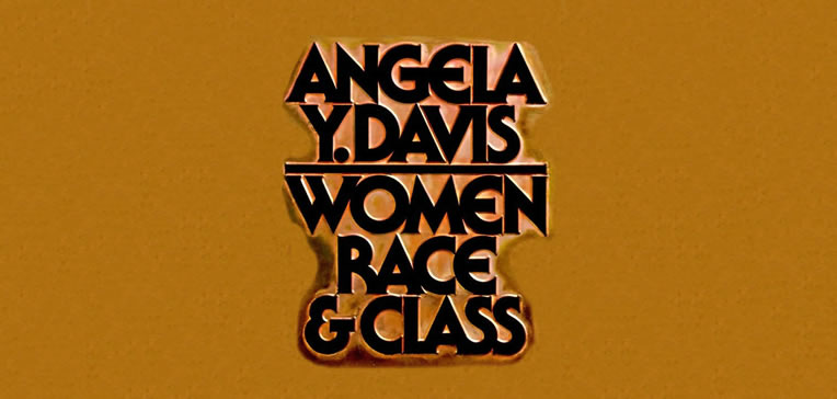 Women, Race, & Class feature image based on book cover art. Bold, embossed, and all caps font against a dark tan background.