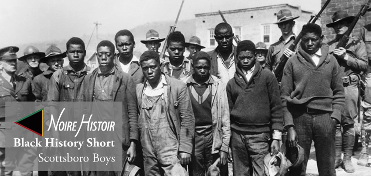 A photo of the eight Scottsboro Boys surrounded by armed guards.