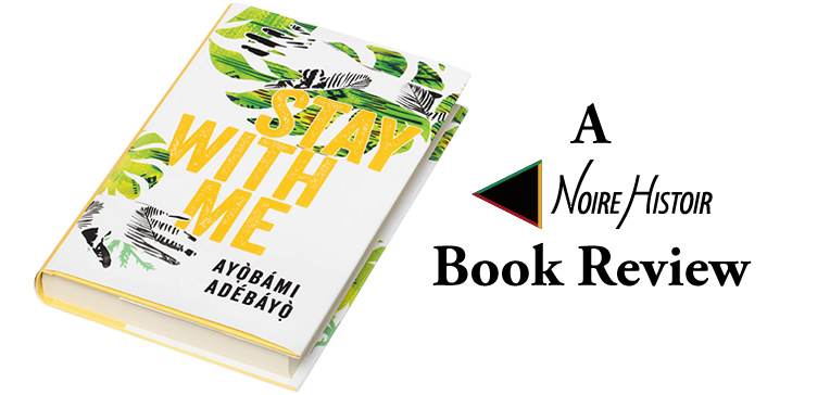 """A copy of """"Stay With Me"""" with the book's cover showing leaves and palm prints in black and shades of green along with the title in yellow and the author's name in black."""