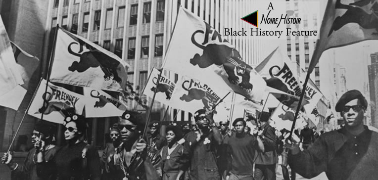 """Black Panther Party members marching and carrying banners during a """"Free Huey"""" demonstration."""