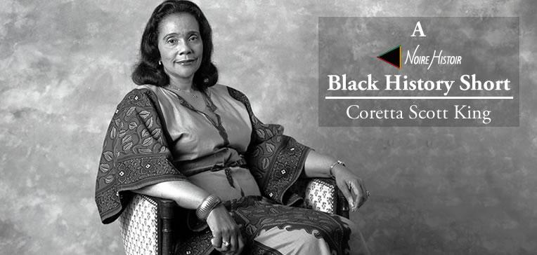 Portrait of Coretta Scott King sitting in a chair.