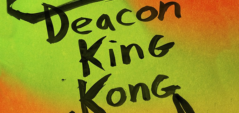 Deacon King Kong feature image based on book cover art depicting black text against a bright multi-color background.