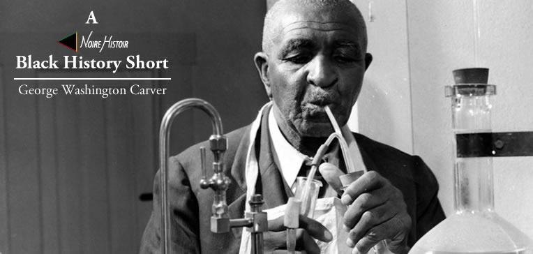 Portrait of George Washington Carver working in his laboratory.