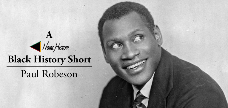 Portrait of a young smiling Paul Robeson.