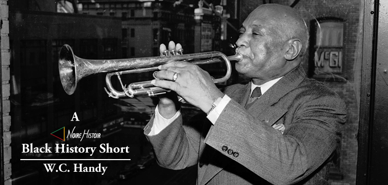 W.C. Handy playing a trumpet.
